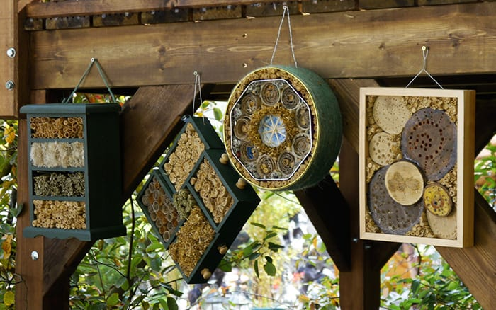 Make DIY bug and insect hotels for bees from recycled household materials