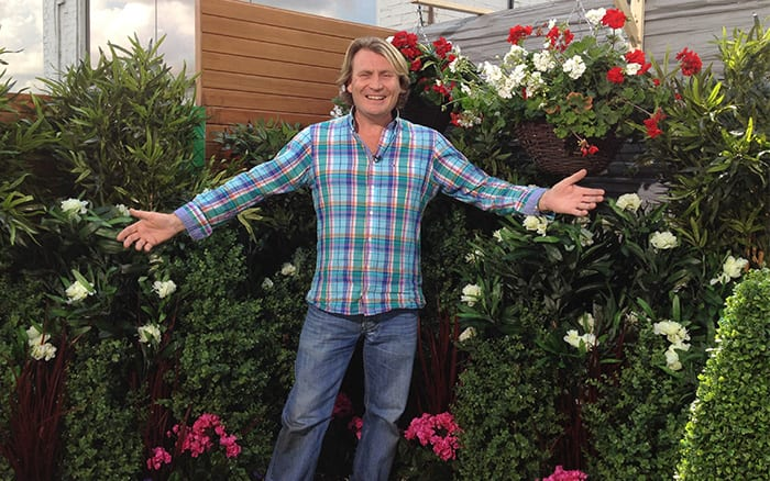 David Domoney in artificial garden with fake plants on ITV This morning