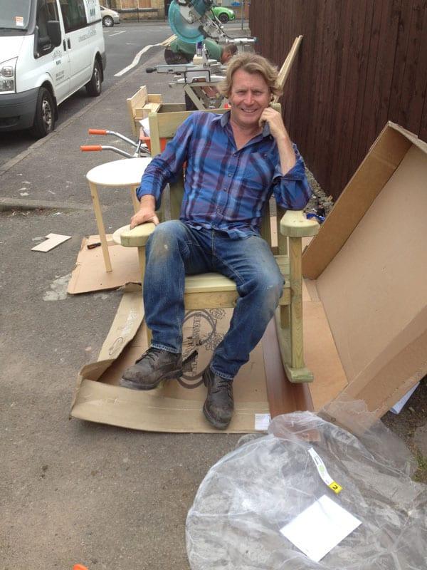 18-love-your-garden-presenter-david-domoney-sitting-in-chair-on-makeover