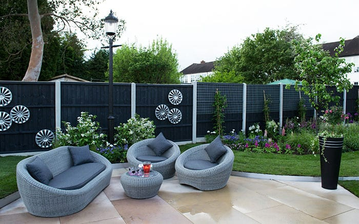patio-seating-area-love-your-garden-wicker-furniture-dark-fence-episode-4
