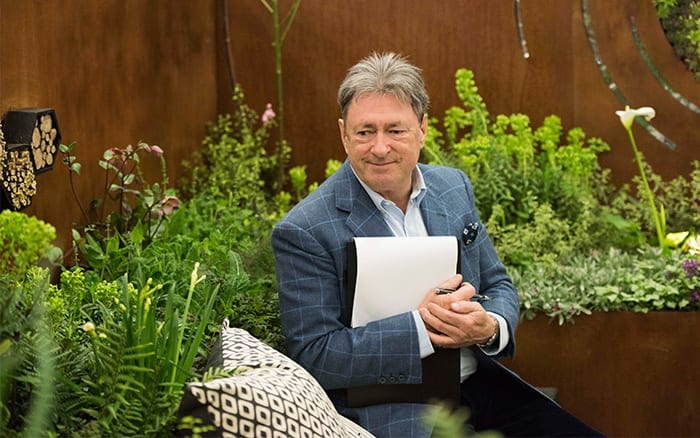 Alan Titchmarsh tests the seating area on Pershore College's Young Gardeners of the Year show garden