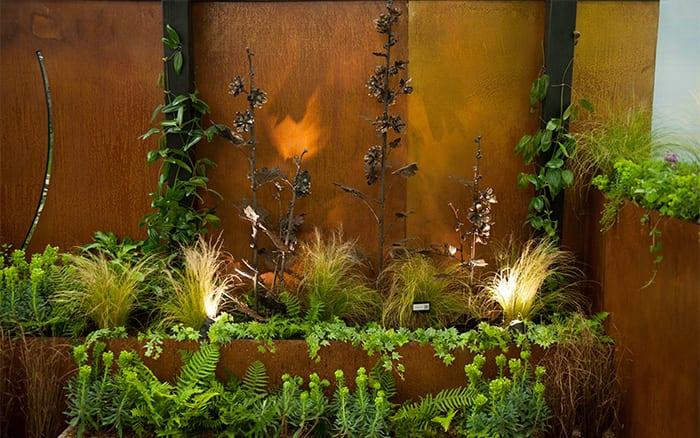 Steel hollyhock sculptures made from scrap metal in the Pershore College Young Gardeners of the Year show garden