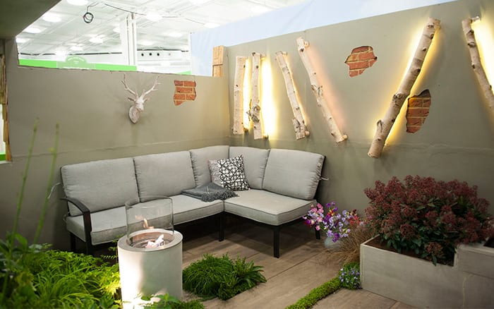 Seating area in Writtle College's Basement Garden show garden at the Ideal Home Show