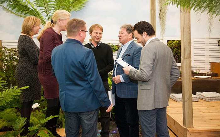 Young Gardeners of the Year judges confer on Capel Manor College's garden
