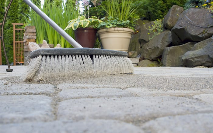 sweep-sand-into-patio-cracks-brush-sand-stop-weeds-paving