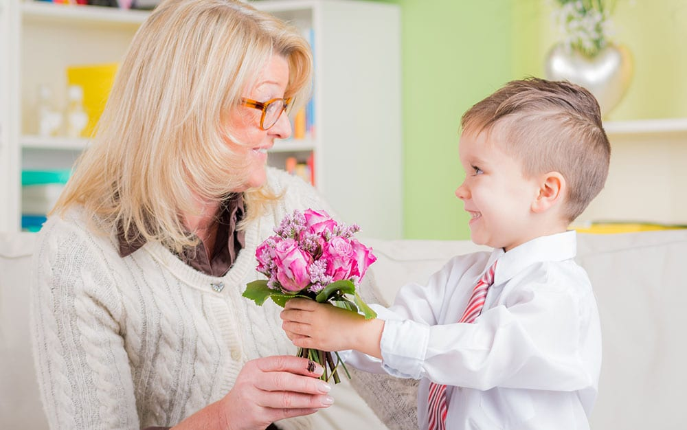 little-boy-giving-flowers-to-mum