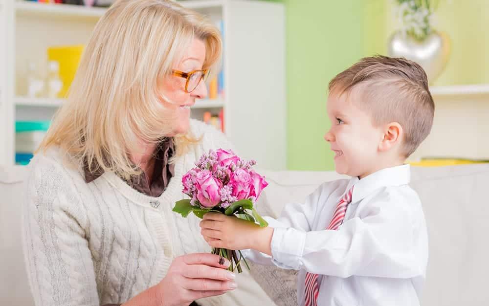little-boy-giving-flowers-to-mum
