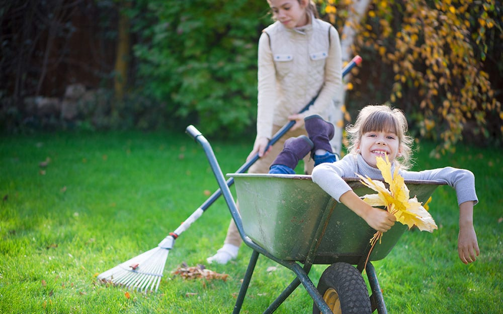 girls-wheelbarrow-rake
