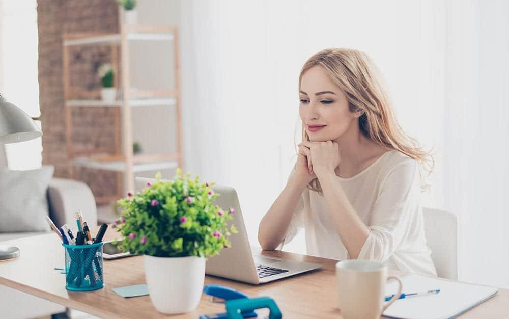 woman office happy plant