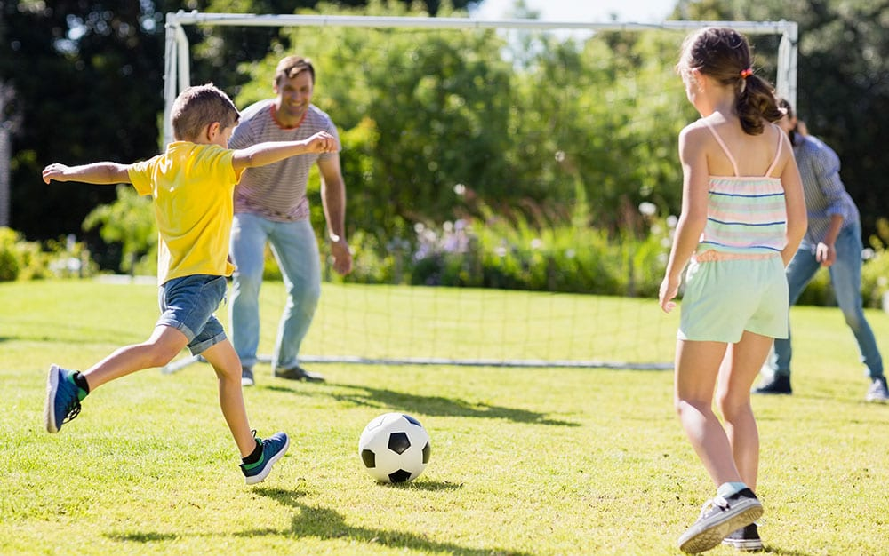 family-playing-football