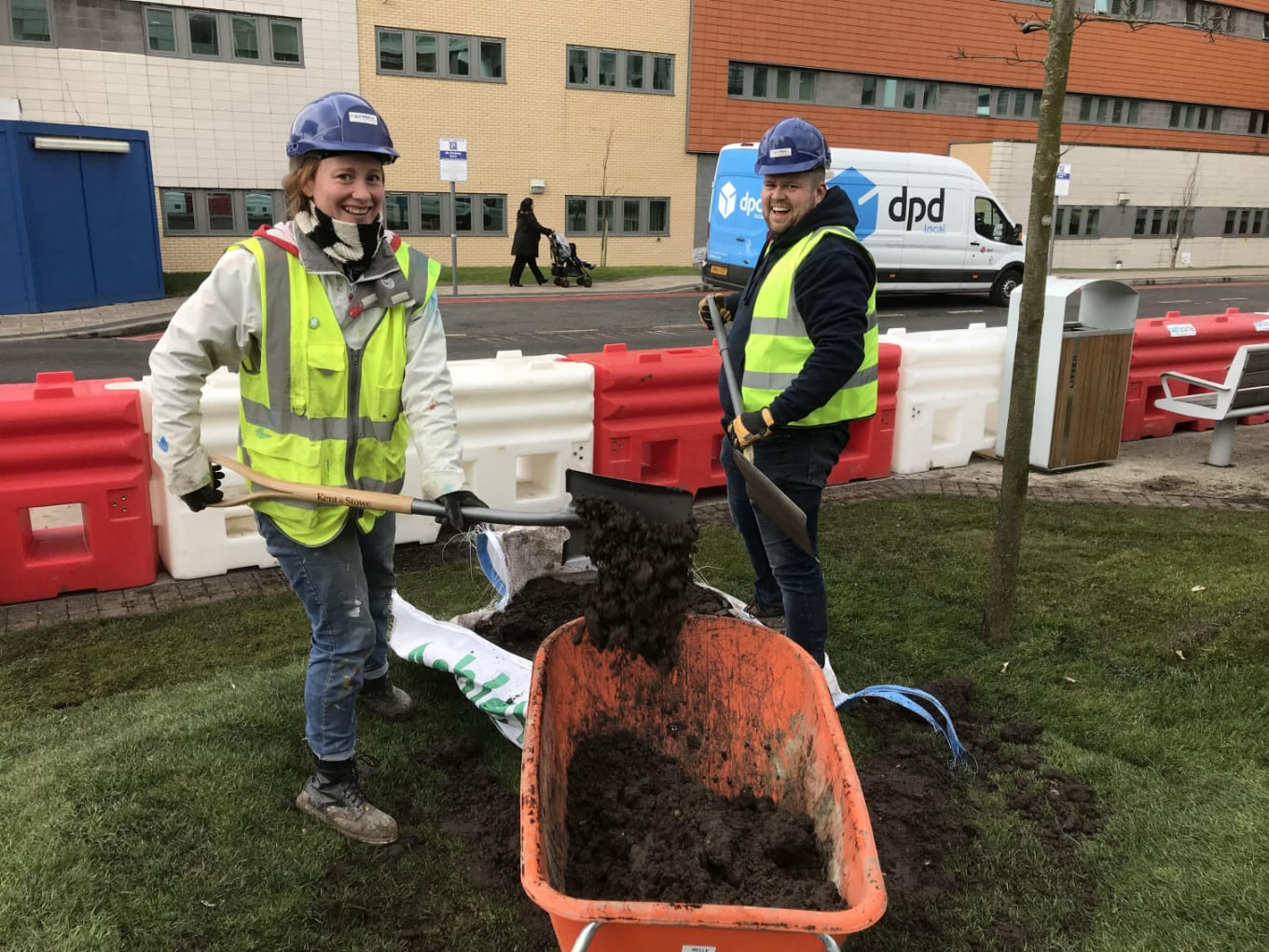Landscaping team filling one of the now famous 'Orange Barrow'